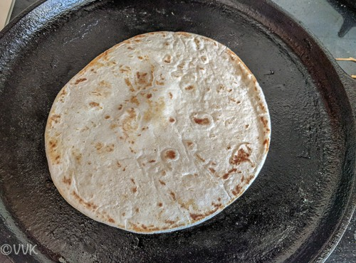Placing four tortilla on a heated griddle