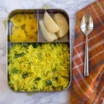 Lemon Sevai or Lemon Flavored Instant Rice Vermicelli served in a metal lunchbox with a metal spoon on the right side