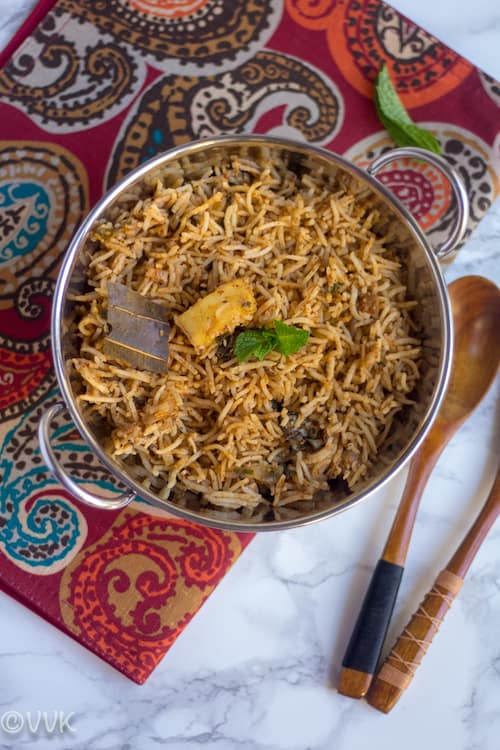 Paneer Biryani ready and served on a fabulous piece of fabrics and a wooden spoon