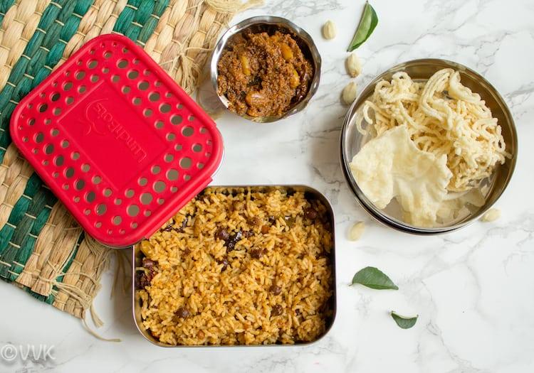 Serving Tamarind Rice or Puliodarai with appalam or vadagam