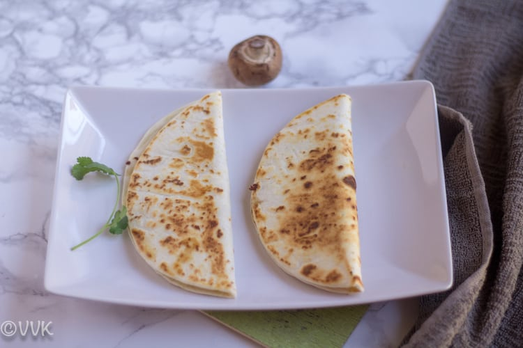 Two Queso Mushroom Quesadillas on a white plate