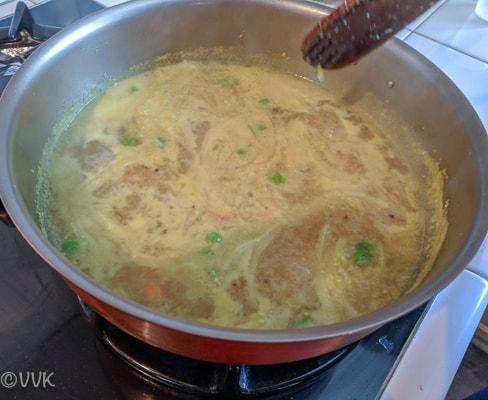 Slowly adding the roasted semiya and rava