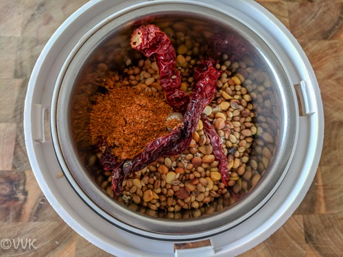 adding the roasted spices in a mixer jar