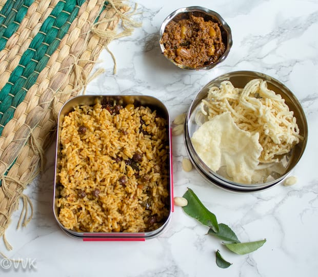 Delicious Tamarind Rice or Puliodarai prepared in a lunchbox and with a few different sides