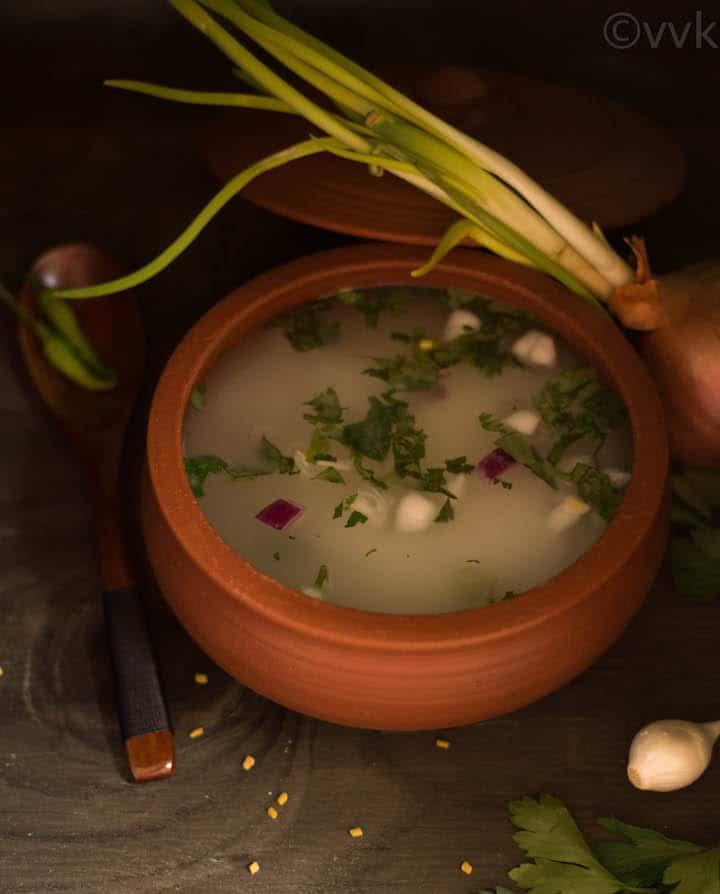 Leftover Rice Porridge with fresh onion next to the bowl