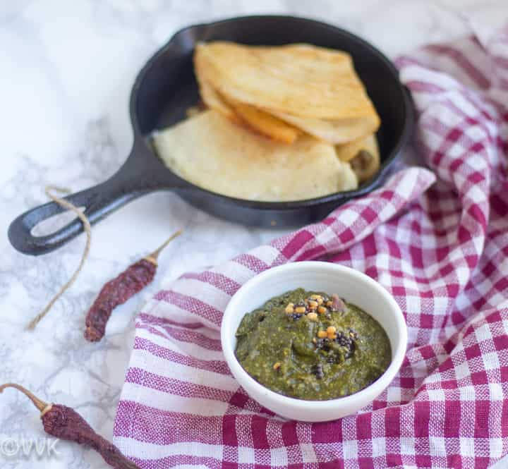 Parsley Chutney served with a full pan of dosas