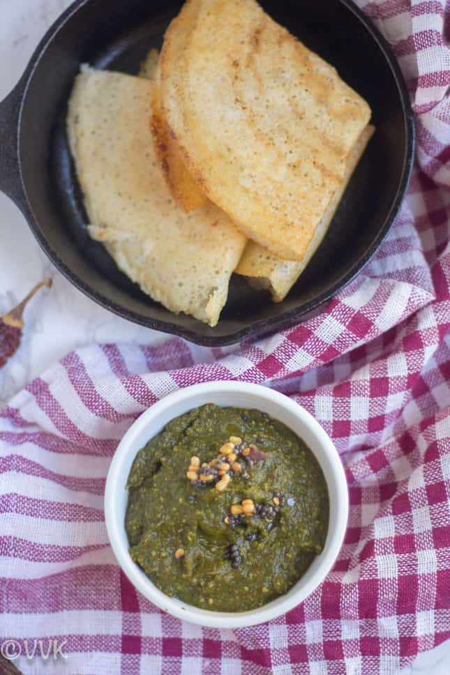 Parsley Chutney with a few of dosas next to the bowl