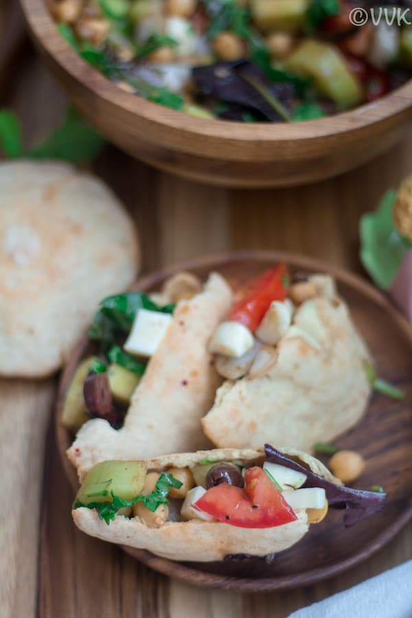 Pita Pocket Salad Wrap served in a wooden plate