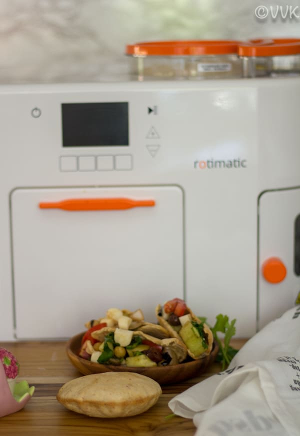 Pita Bread next to Romatic and salad