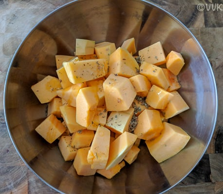 prepping the butternut squash before baking