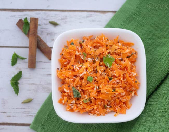 Overhead on the healthy Carrot Coconut Salad or Carrot Kosambari served on a green towel