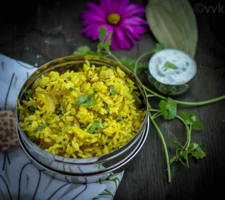 Onion Rice Vengaya Saadam with a side and a beautiful purple flower
