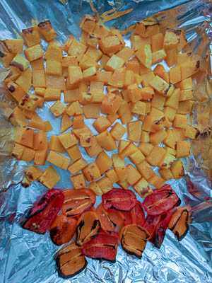 Butternut squash and bell peppers after they have been removed from the oven