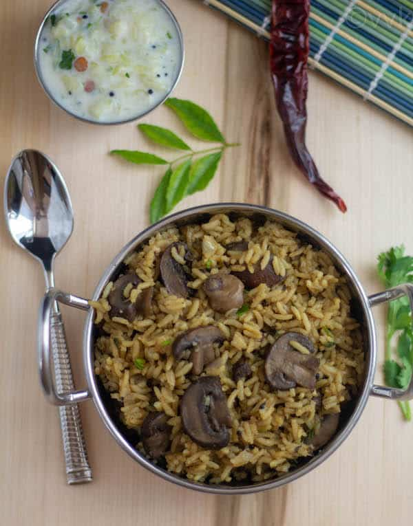 Serving healthy and delicious Mushroom Rice with a spoon