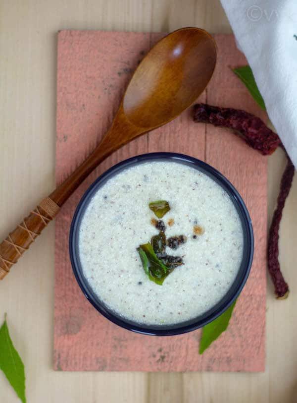 raw buttermilk sambar in a blue bowl
