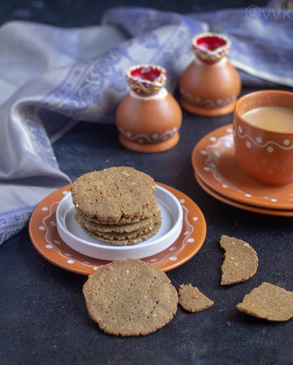 kambu thattai in terracotta plates with tea on the side