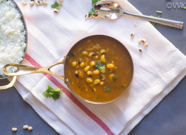 Instant Pot Black Eyed Peas Curry in a pot with a big spoon and a few pins around