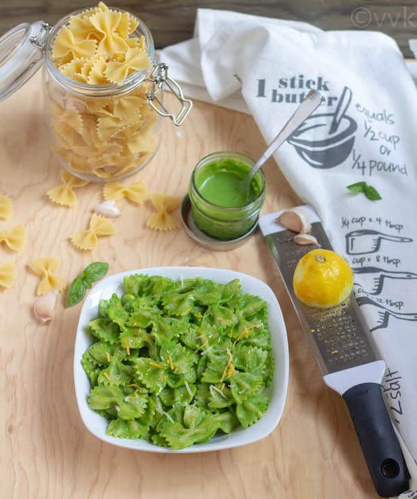 Instant Pot Spinach Pesto Pasta served on a big wooden board