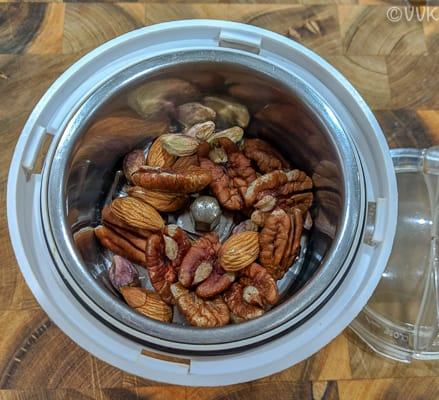 Add nuts to a mixer jar