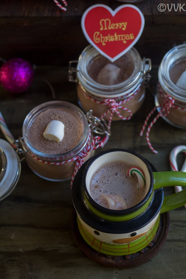 Hot cocoa mix in small jars and hot chocolate made with cocoa mix