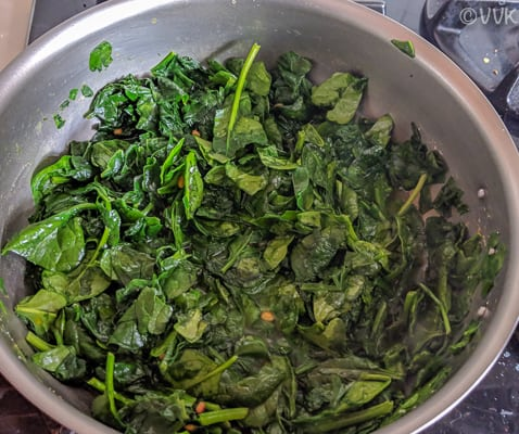 Mixing spinach and allowing it to cook properly