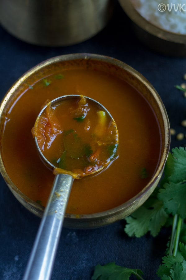 close up shot of rasam. Ladle full of instant rasam
