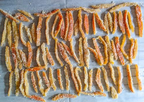 Placing orange peels on a parchment paper