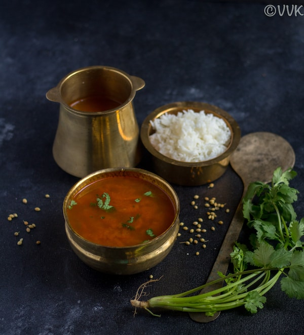kerala style instant rasam in brassware with rice on the top