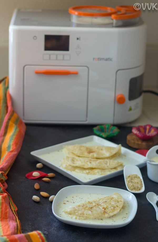Rotimatic Paal Poli Sweetened Milk Poori with Rotimatic in the Background