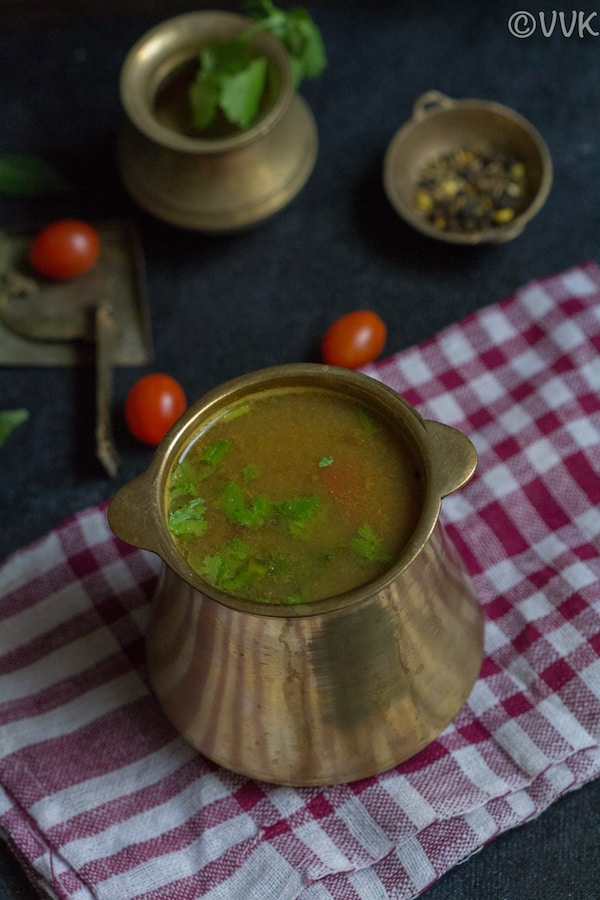 seeragam milagu rasam on a brassware placed on a red towel