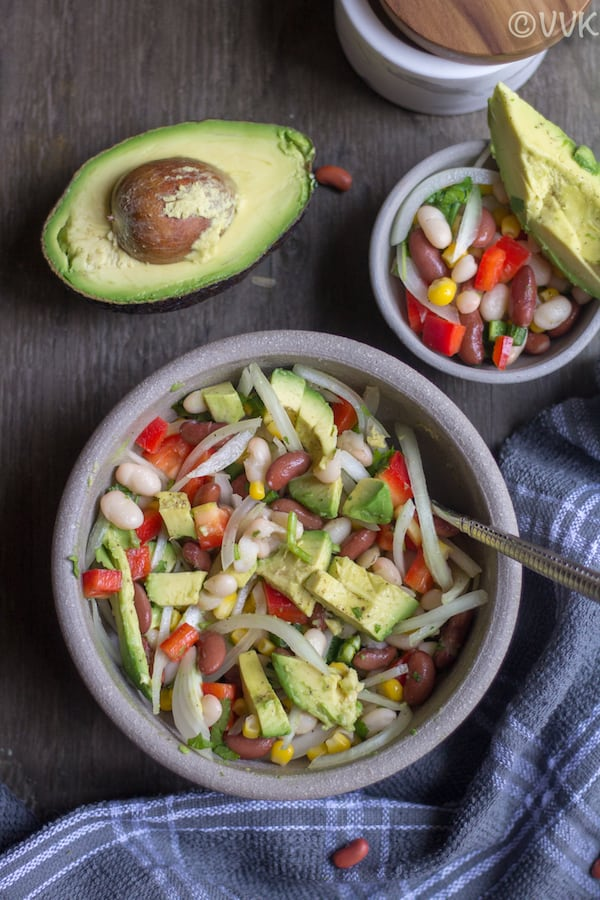 Vegetarian Ceviche Salad - Ceviche Salad with Beans - Beautiful Composition of the Bowl, Avocado and Other Ingredients on the Table