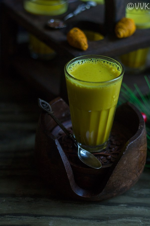 Easy Turmeric Milk - Golden Milk - Served Cup of the Drink with a Spoon on the Side