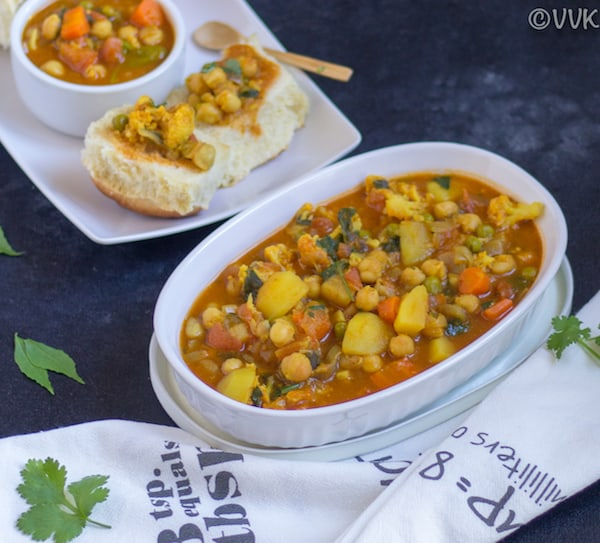 Delicious healthy Vegan Bunny Chow with green herbs around