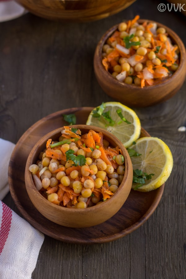 White Peas Carrot Salad with two slices of lemon on the side
