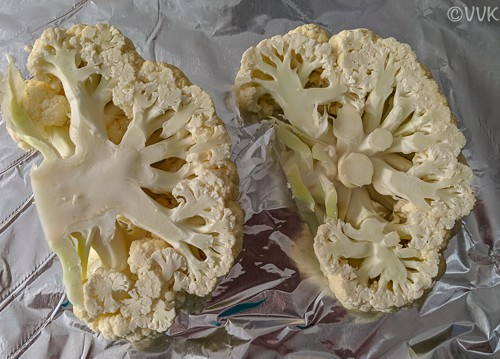 Cauliflower halves placed in a tray
