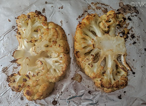 Cauliflower steaks flipped and brushed with the olive oil mix again
