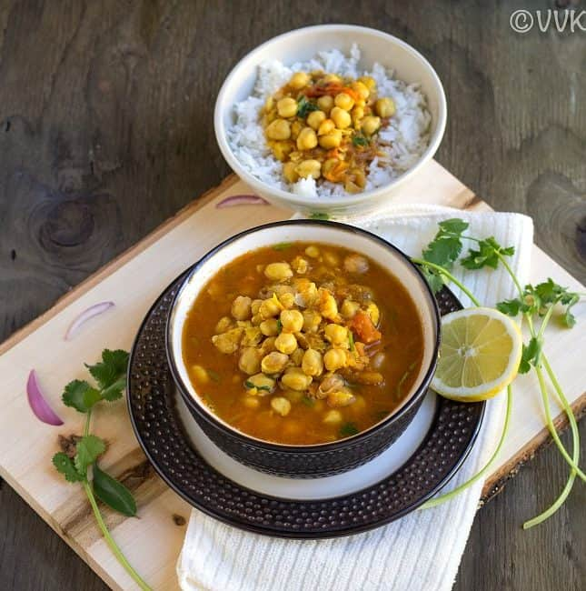 chickpeas curry with rice bowl on the top