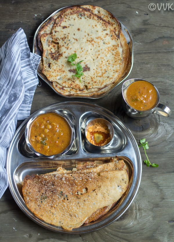 wheat dosai inside partition plate with sambar on the side