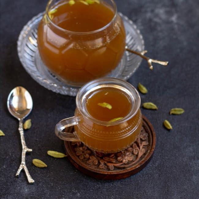 panagam in a tea cup with big pot behind