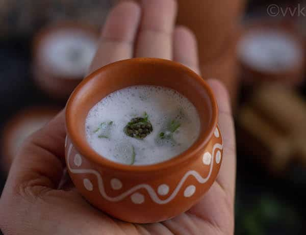 buttermilk in a kulhad cup place on a hand