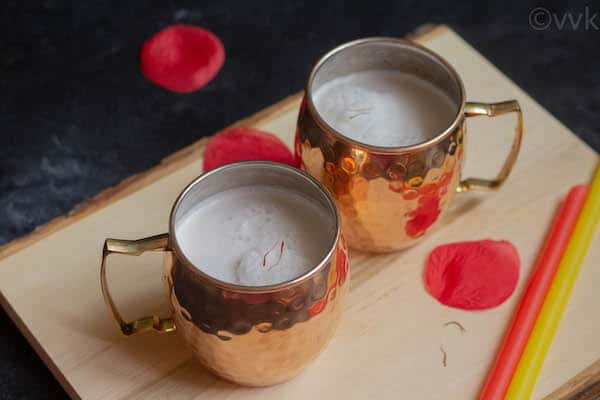tender coconut water kheer in two copper mugs