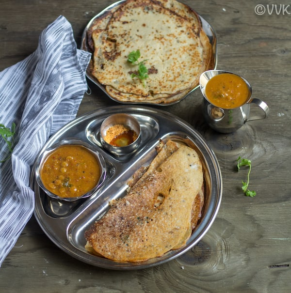 wheat crepes in partitioned plate kept side ways with sambar on the side