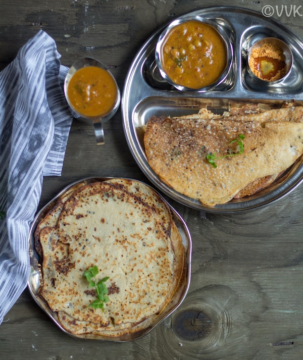 wheat dosai plate with partitioned plate on top with sambar