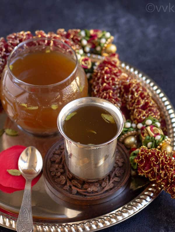 ugadi special panagam in a silver tumbler on a thali plate with garland