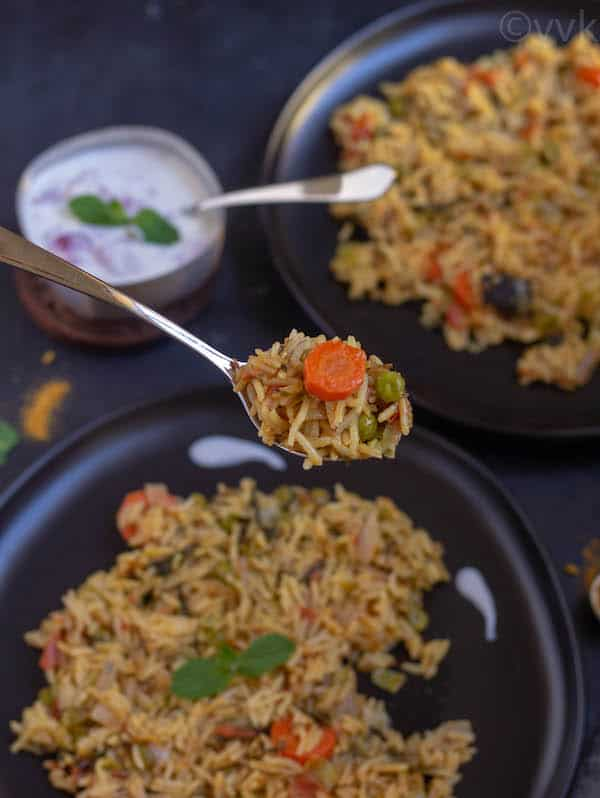 a spoonful of dilli biryani a closeup shot