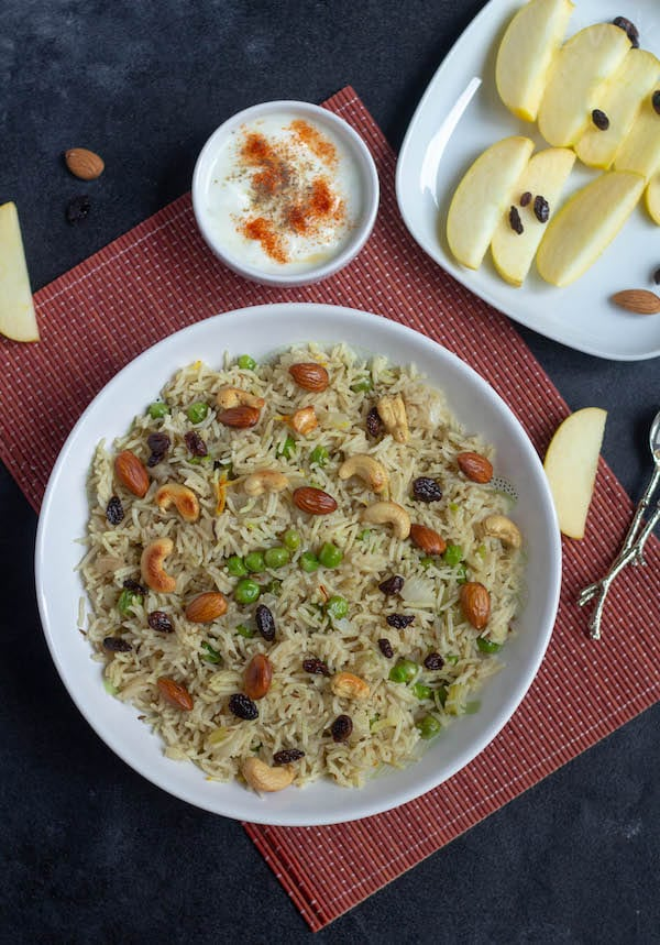 Kashmiri peas pulav top angle with raita and apple slices