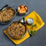 methi pulav in a lunch box with raita and fruits