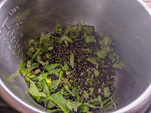instant pot ulutham sadham adding lentils and herbs