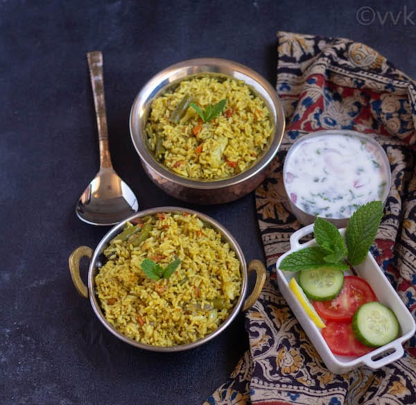 kerala veg biryani with raita and cut veggies