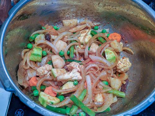 lucknowi biryani adding vegetables